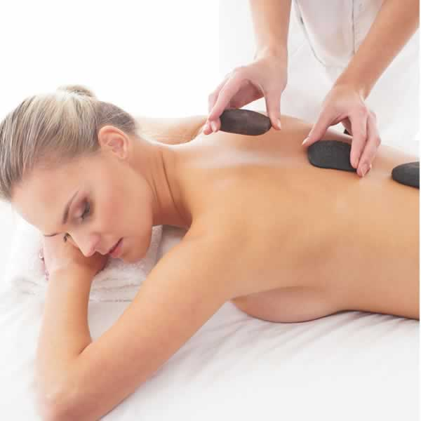 Women getting hot stone Massage