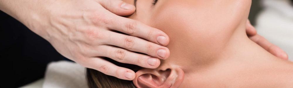 Woman Receiving Facial Massage Treatment