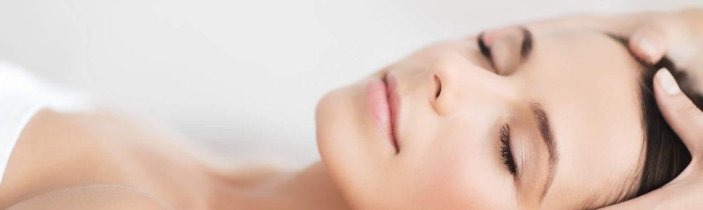 Relaxed Woman Receiving Facial Massage